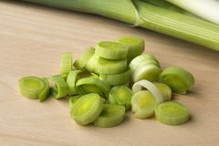 Fresh slices of raw leeks. Heap of fresh slices of raw leeks close up Royalty Free Stock Image