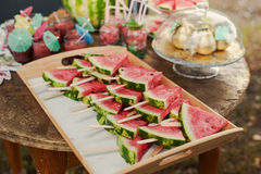 Fresh slices of watermelon on the wooden table. Table with snacks, drinks, cocktails of watermelon Stock Images