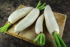 Fresh slices white radish , healthy vegatable. Fresh slices white radish on wooden background, healthy vegatable Stock Photography