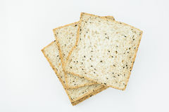 Fresh slices of wholewheat bread with various seeds and multigrain. On wood background Royalty Free Stock Photos