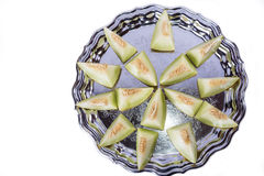 Fresh slices of yellow melon or cantaloupe on the old tray Stock Photos