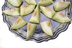 Fresh slices of yellow melon or cantaloupe on the old tray in de Stock Photo