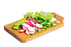 Fresh slised radish, onion and salad on cutting board. Isolated on white Stock Photos