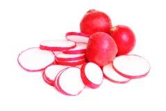Fresh slised and whole radish Royalty Free Stock Image
