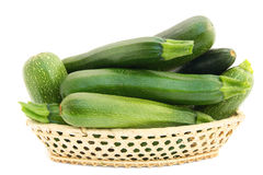 Fresh small green vegetable marrows in a basket Royalty Free Stock Image