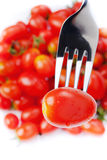 Fresh small tomato on fork Stock Images
