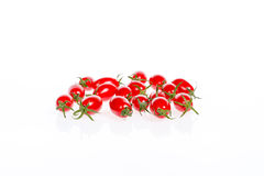 Fresh small tomatoes. Isolated on white background Royalty Free Stock Photos
