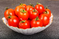Fresh small tomatoes in white salad bowl Royalty Free Stock Photos