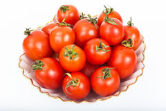 Fresh small tomatoes in white salad bowl Royalty Free Stock Images