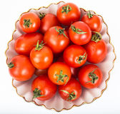 Fresh small tomatoes in white salad bowl Stock Image