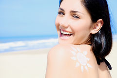 Fresh smile of beautiful female model on the beach Stock Images