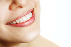Fresh smile of woman with healthy teeth. Over white Royalty Free Stock Images