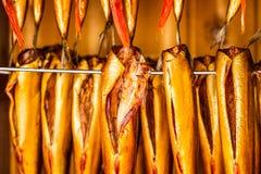 Fresh smoked fish in smokehouse Stock Image
