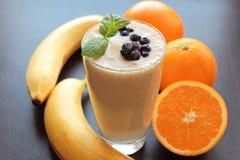 Fresh smoothie with banana and orange Stock Image