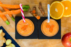 Fresh smoothie with carrot, apple, orange, banana, ginger and tu Royalty Free Stock Photos