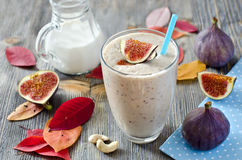 Fresh smoothie with figs and cashew horizontal. Healthy beverage in autumn wooden background Royalty Free Stock Photography