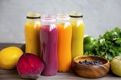 Fresh organic smoothies in bottles with fruits and vegetables royalty free stock photo