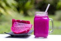Fresh smoothies from a dragon fruit, banana, mango and papaya. Island Bali, Ubud, Indonesia Stock Images