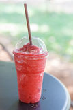 Fresh smoothies raspberry juice in takeaway glass Royalty Free Stock Photography