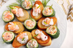 Fresh snack with salmon and shrimp on plate.  Stock Image