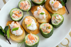 Fresh snack with salmon and shrimp on a plate.  Royalty Free Stock Image