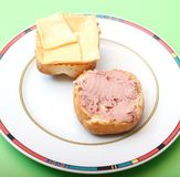 Fresh snack. Some fresh bread with sausage and cheese Stock Images