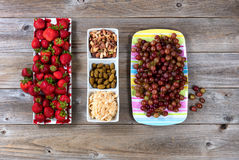 Fresh snacks in dishes on rustic wooden table Royalty Free Stock Photography