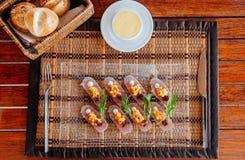 Fresh snapper Tataki with mango salsa and arugulas royalty free stock image