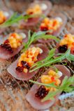 Fresh snapper Tataki with mango salsa and arugulas stock photos