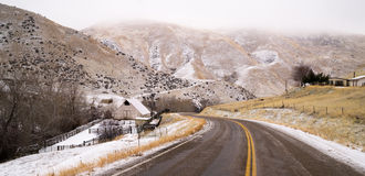 Fresh Snow Blankets Hillside Rural Country Scene Two Lane Road Stock Photography