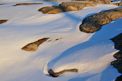 Fresh snow covered granite rocks Royalty Free Stock Image