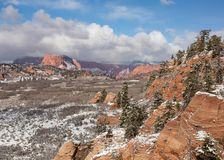 Fresh snow covers the red rock and ponderosa pines in Hop Valley along the Kolob Terrace road in Southern Utah.  royalty free stock images