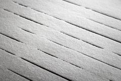Snow on the terrace. Fresh snow covers the wooden floor of the terrace stock photography
