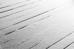 Snow on the terrace. Fresh snow covers the wooden floor of the terrace royalty free stock photo