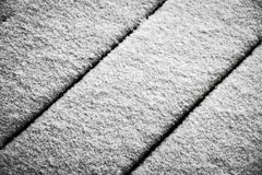 Snow on the terrace. Fresh snow covers the wooden floor of the terrace royalty free stock image