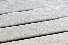 Snow on the terrace. Fresh snow covers the wooden floor of the terrace royalty free stock images