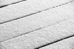 Snow on the terrace. Fresh snow covers the wooden floor of the terrace stock photos
