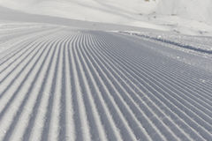 Fresh snow groomer tracks on a ski piste Royalty Free Stock Images