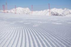 Fresh snow groomer tracks on a ski piste Stock Image