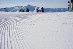 Fresh snow groomer tracks on a ski piste Stock Photos