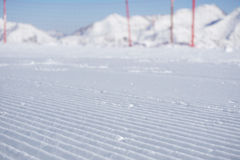 Fresh snow groomer tracks on a ski piste Royalty Free Stock Photo
