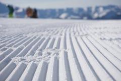 Fresh snow groomer tracks on a ski piste Stock Photo