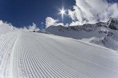 Fresh snow groomer tracks on a ski piste Stock Image