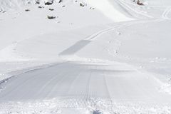 Fresh snow groomer tracks on a ski piste Royalty Free Stock Photography