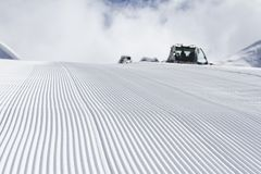 Fresh snow groomer tracks on a ski piste Stock Images