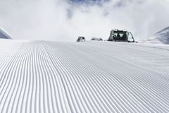 Fresh snow groomer tracks on a ski piste Royalty Free Stock Images