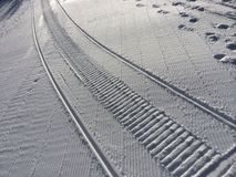 Fresh snow groomer tracks Stock Image