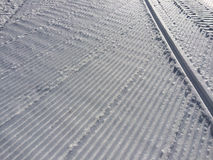 Fresh snow groomer tracks Stock Images