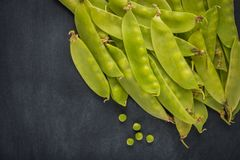 Fresh snow peas pod on slate background. Stock Photo