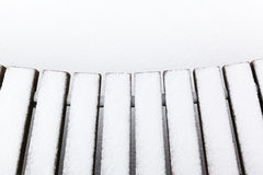 Fresh snow on the seat bench Royalty Free Stock Photos